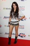 Miley Cyrus very leggy in shorts at Capital FM Jingle Bell Ball in London - Hot Celebs Home