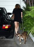 Lindsay Lohan shows legs as she takes the dog out in Hollywood with Samantha Ronson